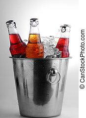 beer bottles - three different beer bottles in bucket of ice...