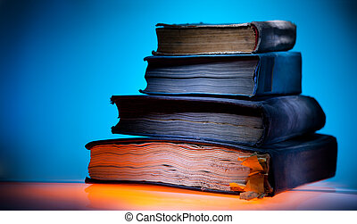 Old books, blue light background - Old books, mystical blue...