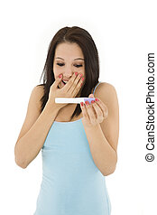 Pregnancy Test - Young Caucasian woman looking at pregnancy...