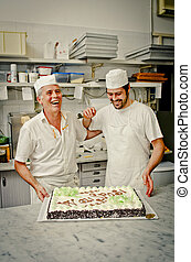 Father and son at work in pastry lab