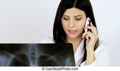 Female doctor talking on the phone - Gorgeous female doctor...