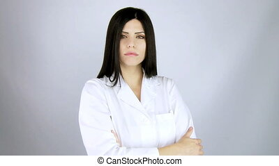 female doctor looking serious - beautiful female doctor...