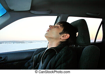 young man sleeping - young man sleeps in passenger...