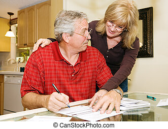 Sign Here Honey - Senior woman persuading her husband to...