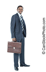 Portrait of smiling African American business man standing...