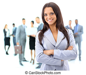 Portrait of a young business woman with people discussing in...