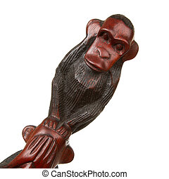 Hear no evil - Old wooden statue of a monkey, hear no evil