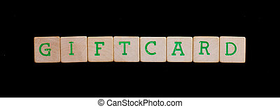 Green letters on old wooden blocks giftcard