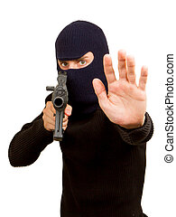 Photo of terrorist with gun attacking someone while pointing...
