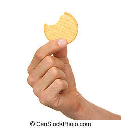 Man with a biscuit in his hand