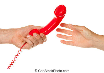 Man giving red telephone to woman