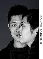 Close-up portrait of asian couple