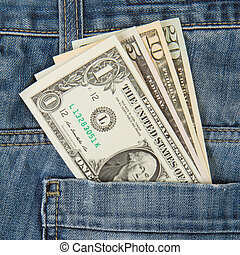 Macro shot of trendy jeans with american four different dollar bills on its pocket