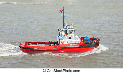 Red tug - ROTTERDAM, THE NETHERLANDS - JUNE 22: Red tug is...