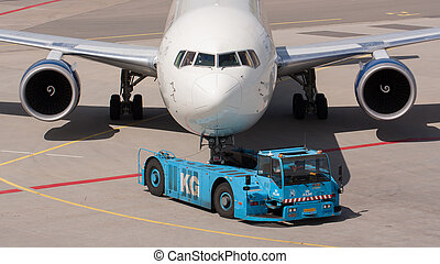Delta Boeing 737 is pulled by a special tow car - AMSTERDAM...