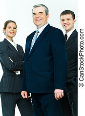 Mature leader - Portrait of business team with mature leader...