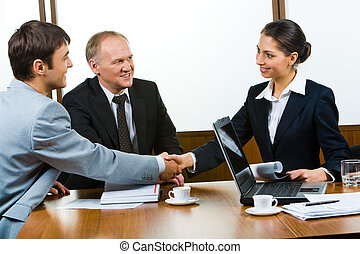Important deal - Confident partners sitting at the table and...