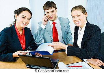 Business group - Group of three business people sitting at...