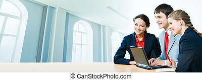 Three office workers - Photo of three office workers sitting...
