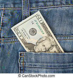 Macro shot of trendy jeans with american 20 dollar bill on...