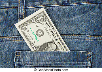 Macro shot of trendy jeans with american 1 dollar bill