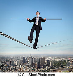 Balancing businessman and cityscape - Business man balancing...