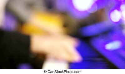 Piano Playing Blur Version - Hand Playing Piano by Out Focus...