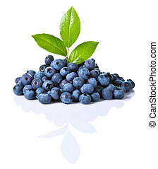 Blueberries - Fresh blueberries with green leaves isolated...