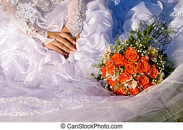 Bridal bouquet and hands of bride