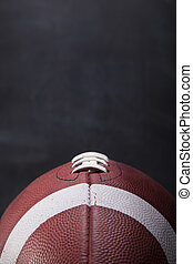 Football Contrast - An American football with a chalkboard...