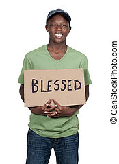 Man Holding Sign that says Blessed - Handsome young man...