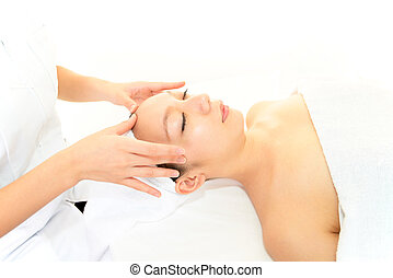 Woman receiving facial massage - Beautiful woman receiving...