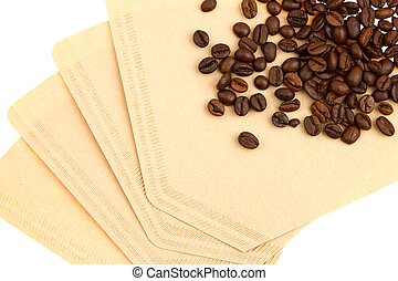 Coffee beans on a coffee filter (white background)