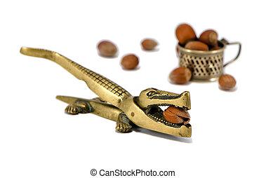 crocodile nut crack tool cobnut isolated on white - Steel...