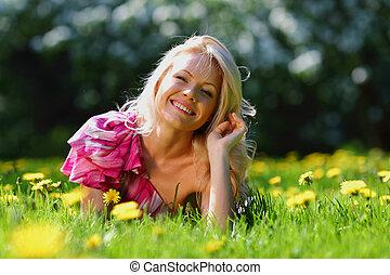girl on dandelion field