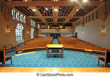 Rows of pews in a synagogue - Pews in a synagogue facing the...