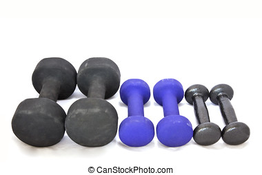 Assorted free weights - Different size free weights in a row...