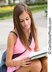 Very cute young student girl outdoors.