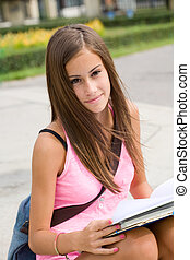 Gorgeous young student girl in the park. - Portrait of a...