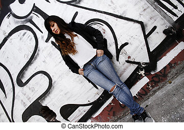 Girl leaning on a Wall - A young woman leaning on a wall.
