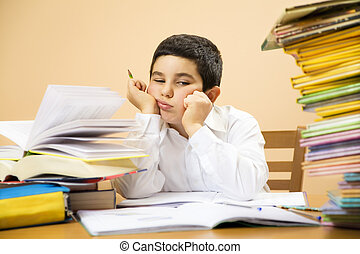 children - little boy getting bored of his homeworks