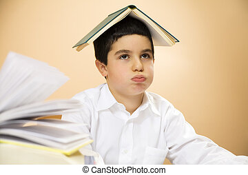 children - little boy getting bored of doing homeworks