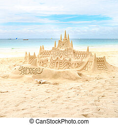Sand castle on the picture perfect white tropical sandy...