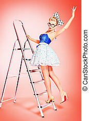 upstairs - Beautiful young woman with pin-up make-up and...
