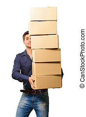 A Young Man Holding A Stack Of Cardboard Boxes On White...