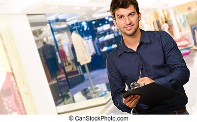 Young Man Holding Clipboard, Indoor