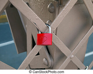 Red Heart Lock - A red padlock with a heart carved into it,...