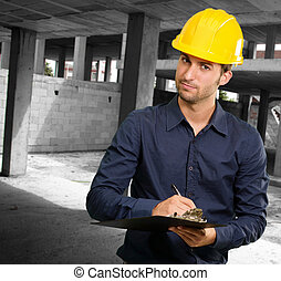 Technician Using Clipboard At Construction Site