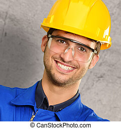 Portrait Of An Engineer Near Wall