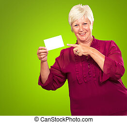 Portrait Of A Senior Woman Pointing To The Blank Card On...